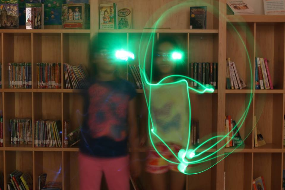 children making shapes with glowing lights